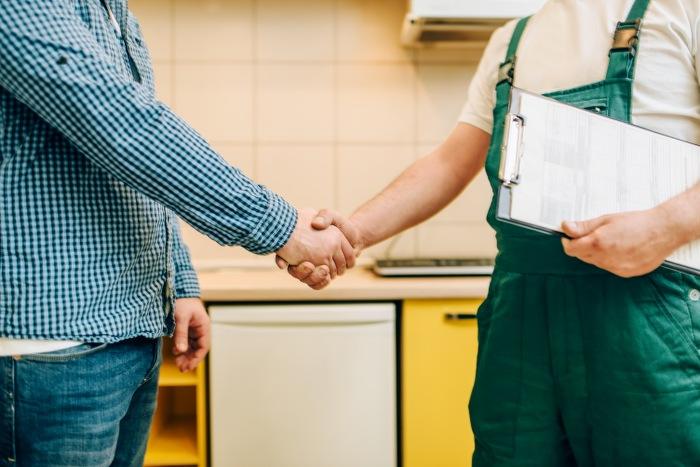 handyman and customer shake hands