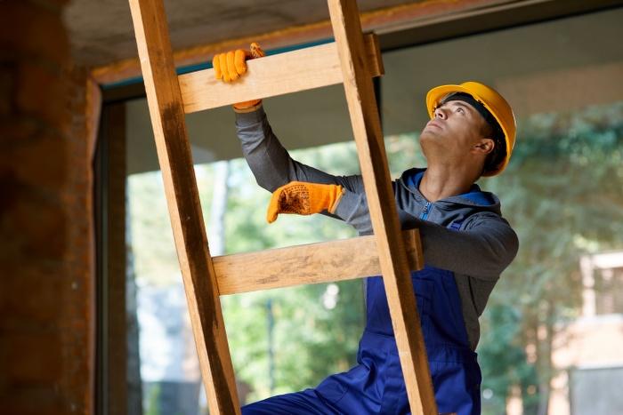 man climbing up the ladder