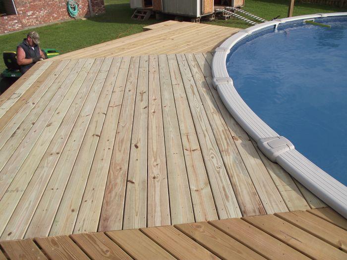man inspecting pool deck