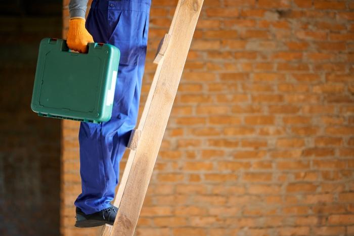 man climbing up-the ladder